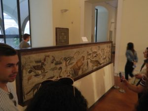 Students looking at a piece of art