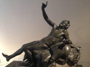 A sculpture of a drunken satyr